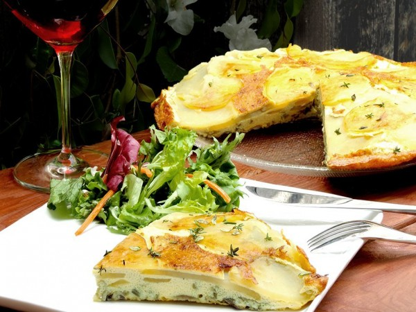 Potato and onion frittata is a delicious and rustic Italian recipe made with creamy potatoes. Serve with fresh green salad and pair with a glass of wine
